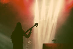 Guitarist silhouette in smoke during concert Stock Photo