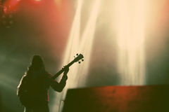 Guitarist silhouette in smoke during concert Royalty Free Stock Images