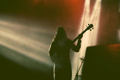 Guitarist silhouette in smoke during concert Royalty Free Stock Photography