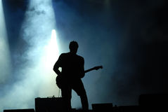 Guitarist silhouetted at concert Stock Photos