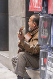 Guitarist sitting on the sill of the Museum José Guerrero agai Royalty Free Stock Images