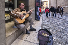 Guitarist sitting on the sill of the Museum José Guerrero agai Royalty Free Stock Photos