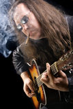 Guitarist smoking cigar Royalty Free Stock Photography