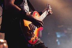 Guitarist on stage for background, abstract Royalty Free Stock Images
