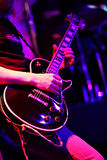Guitarist  on stage for background, colorful, soft focus and blur. Shallow DOF, selected focus Stock Photo