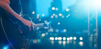 Guitarist on stage for background, soft and blur concept. Guitarist on stage night for background, blue tone soft and blur concept Stock Images