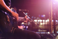 Guitarist on stage for background, soft and blur concept. Guitarist on stage on lighting for background, soft and blur concept stock photo