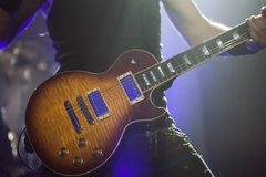 Guitarist on stage, guitar closeup. Guitarist on the stage, electric guitar closeup Royalty Free Stock Photo