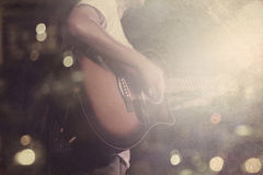 Guitarist on stage grunge background, vintage and retro color tone Royalty Free Stock Images