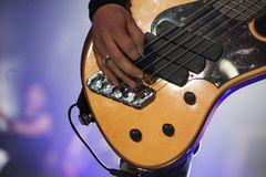 Guitarist on stage, guitar closeup. Guitarist on the stage, electric guitar closeup Stock Image