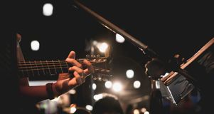 Guitarist on stage. Guitarist playing guitar. Guitarist on stage. Guitarist playing guitar, soft and blur concept Royalty Free Stock Photography