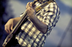Guitarist on stage. Guitarist performing on the stage Royalty Free Stock Photos