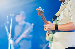 Guitarist on stage. Guitarist show solo on stage, selective focus Royalty Free Stock Images