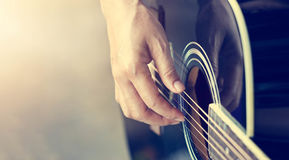 Guitarist on stage, soft focus Royalty Free Stock Images