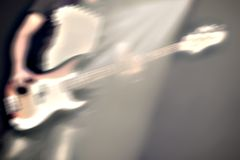 Guitarist on stage in a spotlight Royalty Free Stock Photos