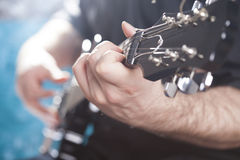 Guitarist on stage Stock Image