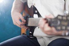Guitarist on stage Stock Images