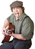 Guitarist Sticking Out His Tongue Royalty Free Stock Photos