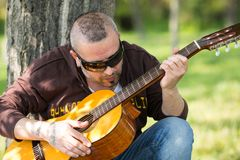 Guitarist in the street Royalty Free Stock Photography