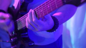 The guitarist strikes the strings close-up. Playing the guitar close-up. Guitarist plays the guitar. stock video footage