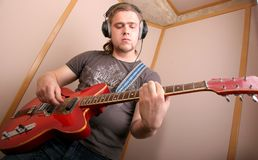 Guitarist in studio Royalty Free Stock Images