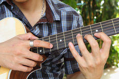 The guitarist tapping technic of guitar. The guitarist tapping technic to fingerboard of guitar Stock Photo