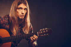 Guitarist trying out chords. Stock Photo