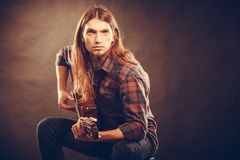 Guitarist trying out chords. Stock Photography