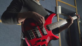 Guitarist tunes on the concert or try-out pop band. stock video footage