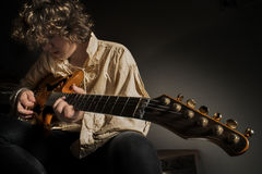 Guitarist-Young man playing guitar Royalty Free Stock Images