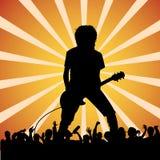 Guitariste à un concert de rock Photographie stock libre de droits