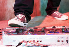 Guitarists' Foot on distortion panel Stock Photography