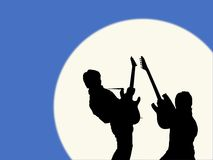 Guitarists in the moonlight Stock Photos