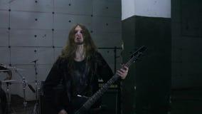 Guitarists playing in hangar stock video