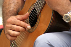 Guitarplayer. Man playing the guitar on a marketplace Royalty Free Stock Photos