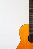 Guitarra acústica anaranjada Foto de archivo