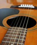 Guitarra acima 1 próximo Fotografia de Stock Royalty Free
