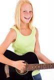 Guitarra adolescente de la muchacha Imágenes de archivo libres de regalías