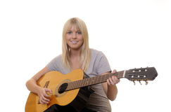 Guitarra adolescente de los juegos Foto de archivo