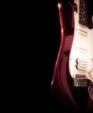 Guitarra aislada en un fondo negro Imagen de archivo libre de regalías