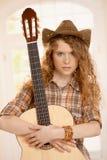 Guitarra atractiva del abarcamiento de la muchacha Imagen de archivo