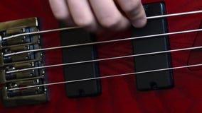 Guitarra baixa video estoque