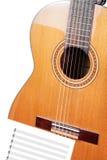 Guitarra con las notas. Fotografía de archivo