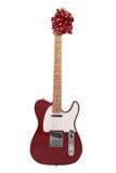 Guitarra con un arqueamiento rojo imagen de archivo libre de regalías