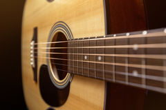 Guitarra de madera acústica Foto de archivo libre de regalías