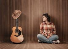 Guitarra del sombrero de vaquero Foto de archivo