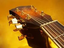 Guitarra do ouro Imagens de Stock
