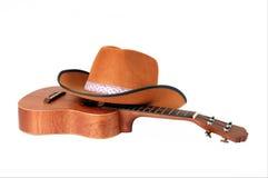 Guitarra e chapéu Imagem de Stock Royalty Free