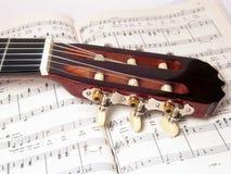 Guitarra e nota Imagem de Stock