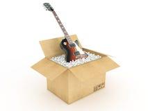 Guitarra eléctrica en caja de cartón Imagen de archivo libre de regalías